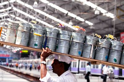 Dabbawala in action at a station in Mumbai